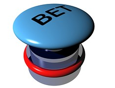 "A blue elevated button with the inscription ""Bet"""