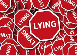 """A Pentagon road sing with the inscription """"Lying"""""""