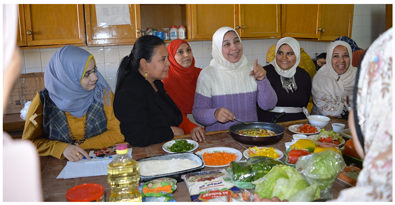 Egyptian women cooking quinoa in kitchen.