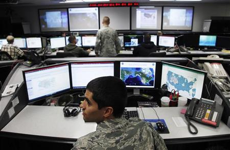 2Lt William Liggett works at the Air Force Space Command Network Operations & Security Center at Peterson Air Force Base in Colorado Springs