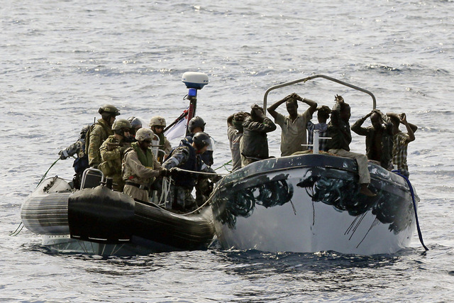 HMAS Melbourne's boarding party intercepts a suspected pirate boat. *** Local Caption *** Royal Australian Navy ship, HMAS Melbourne operating off the coast of Somalia, intercepted suspected pirates as part of a Combined Task Force 151 tasking for Combined Maritime Forces on 15 October 2013.