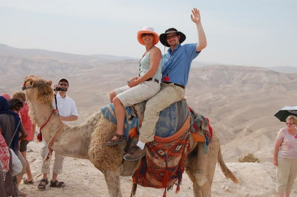 Eric and Aimee Vanderburg riding a camel in Israel
