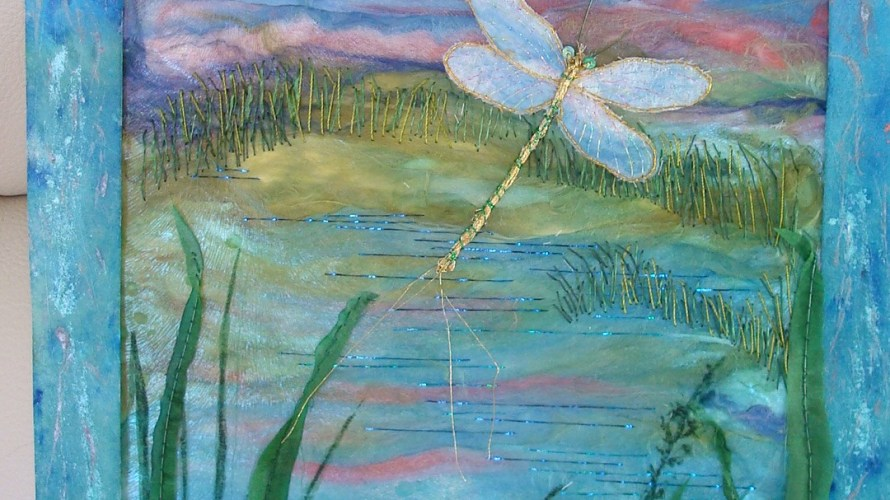 Painted silk, Paper dragonfly with translucent wings attached separately.  Textile fronds and grasses.
