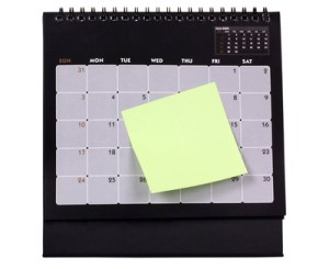 Adhesive note attached with a calendar