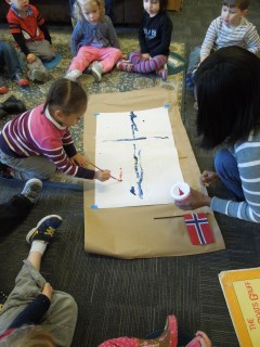 Two year olds learning about Frozen took time to get to know about the country on which it is meant to be based. Here they are painting their own Norwegian flag before reading a Norwegian folk tale and learning about the animals that inhabit that region.