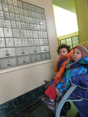 Mobile infants take a trip to the post office to mail a letter during their unit on communication.