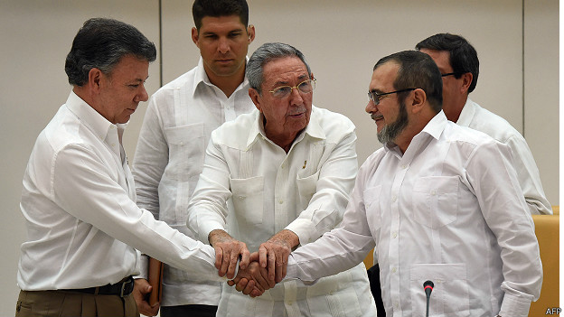 "Colombian president Santos and FARC leader alias ""Timochenko"" shake hands after finalizing the content of the peace deal in Havana, Cuba. Source: http://www.bbc.com/mundo/noticias/2015/09/150923_colombia_farc_paz_anuncio_az"