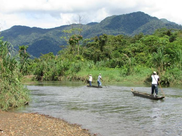 Going upriver in canoe with farmers whom I worked with during my two years in Chocó