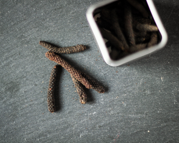 Red Long Pepper with its metal tin