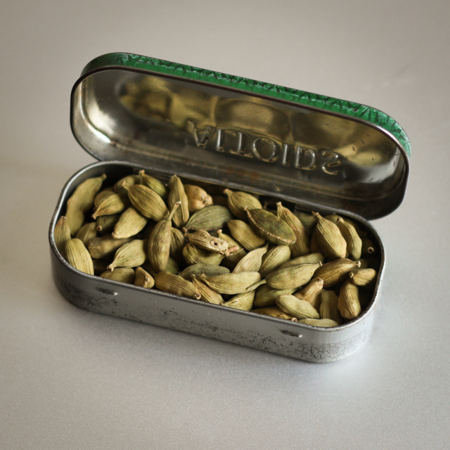 a chewing gum box full of cardamom pods