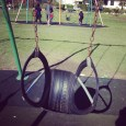 Swing set. Made of tires. Not the same, but a swing set nonetheles. A SWING SET.
