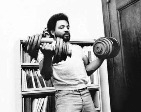 Image of Ernie Chambers lifting weights.