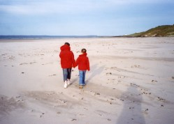 Beach walks with the sibling child. Northumberland, UK 2007