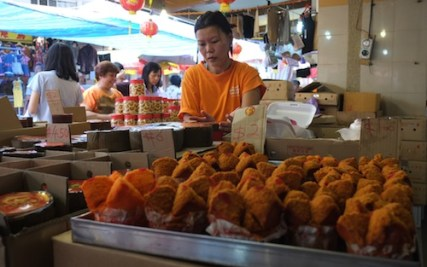 A vendor sells Chinese New Year goodies in Singapore