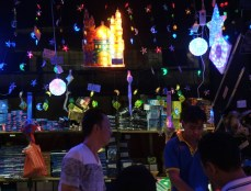 A man sells light decorations at a market