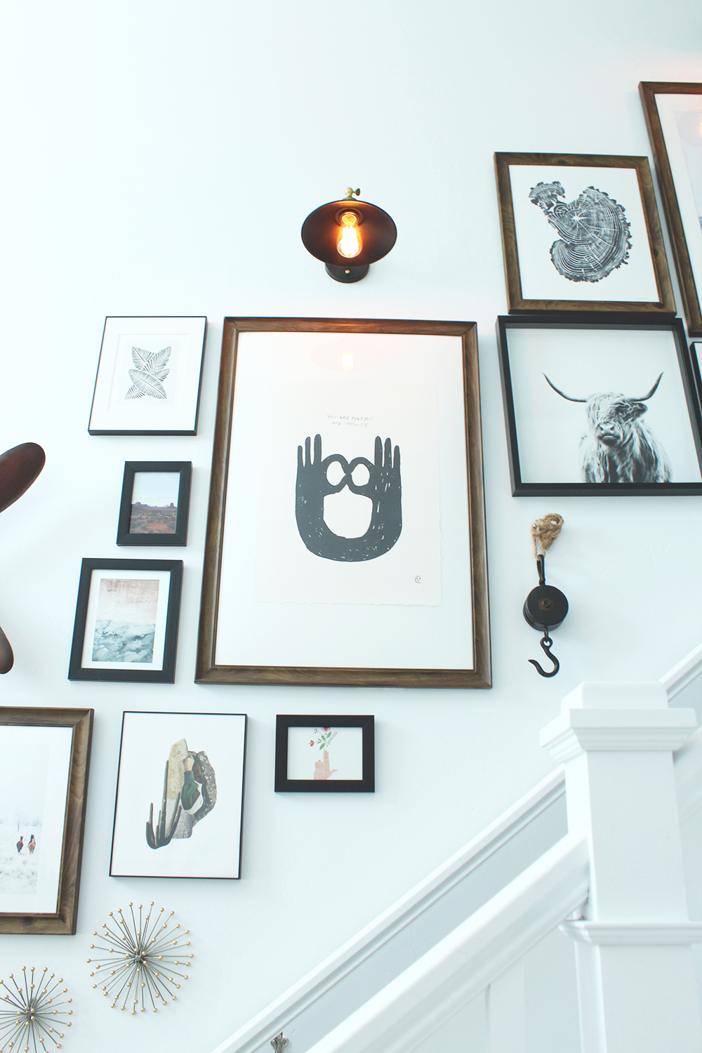 seeking alexi gallery wall with light & light wood stamp print