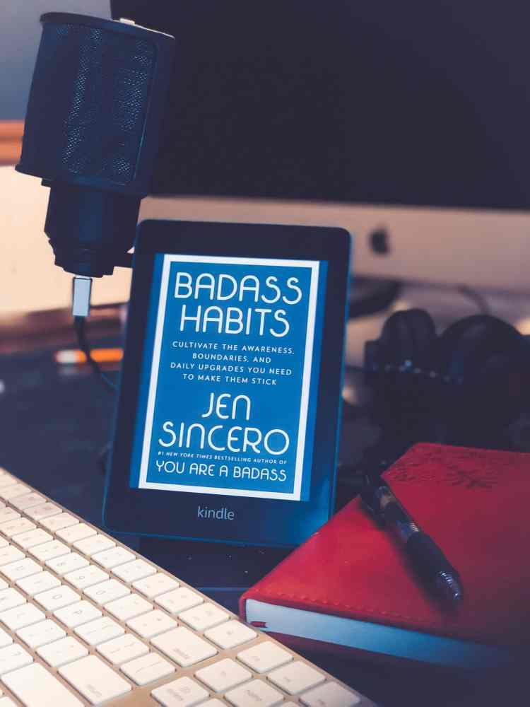 A Kindle device with the cover of Badass Habits on the screen