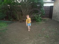 Caleb helping spread dirt(we took out some trees