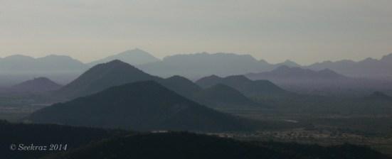 City mist among the desert hills