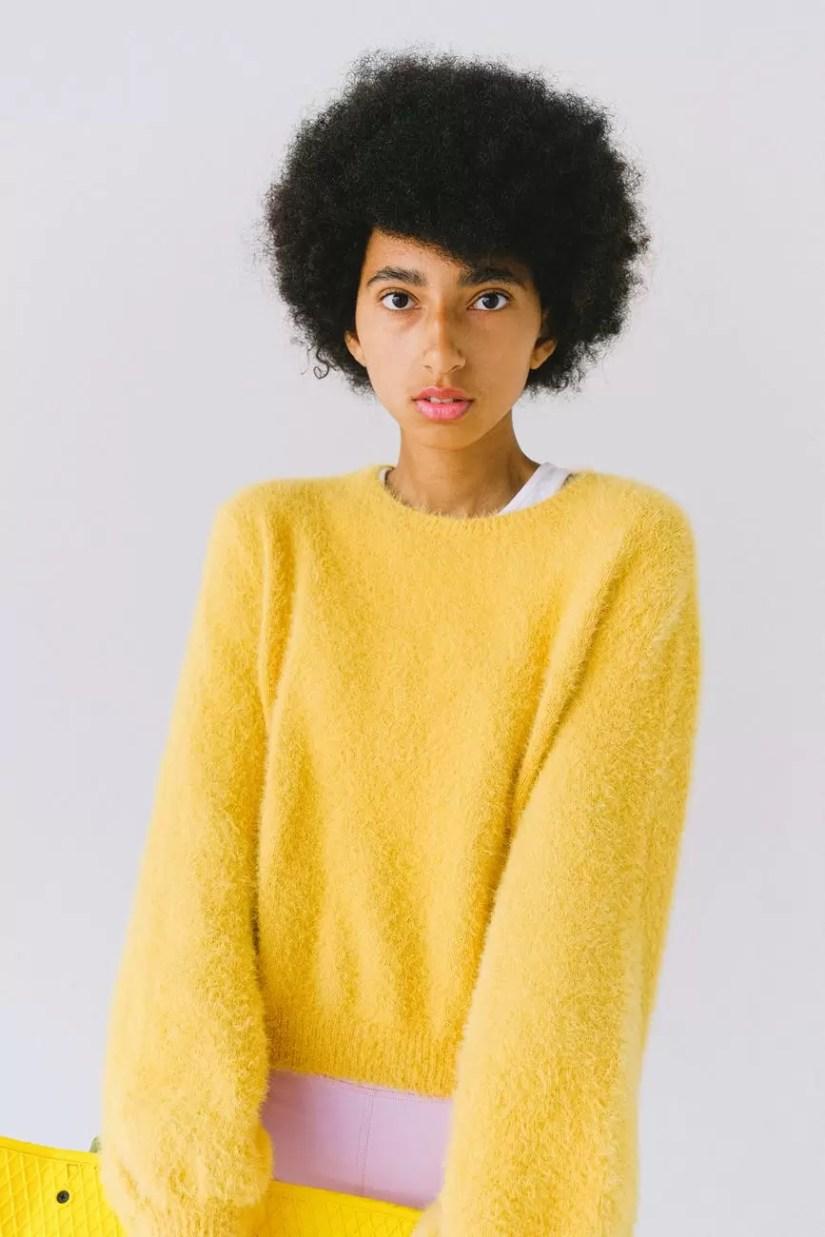 ethnic teen in bright yellow stylish sweater