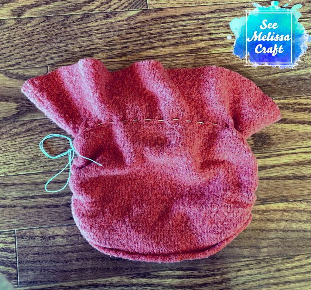 Running stitch sewn on upcycled child's hat