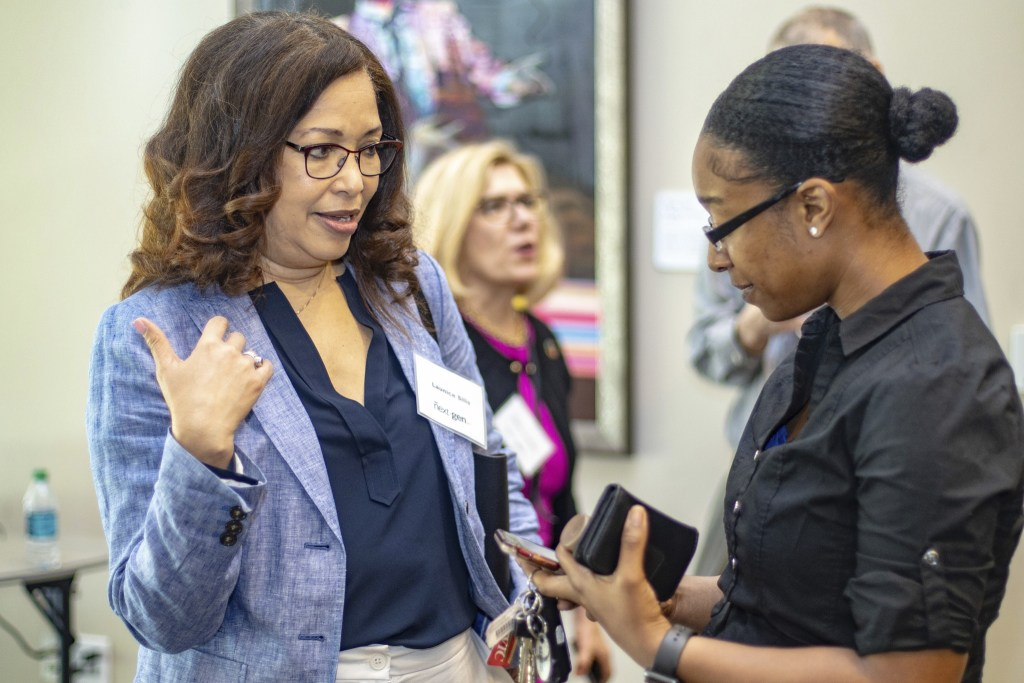 Networking discussion between two women