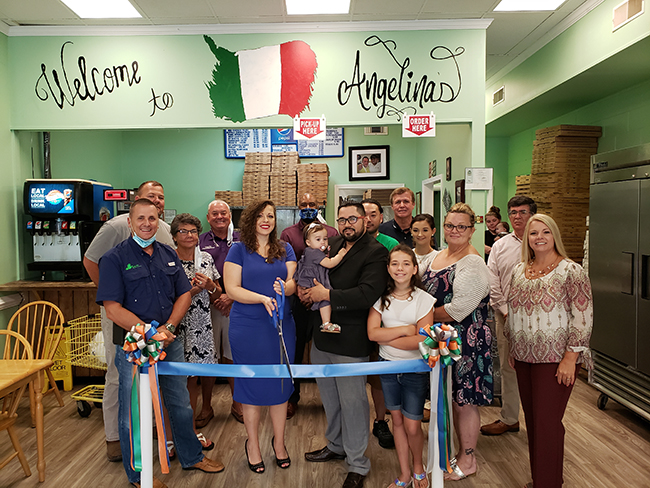 Blue ribbon cutting at Angelina's