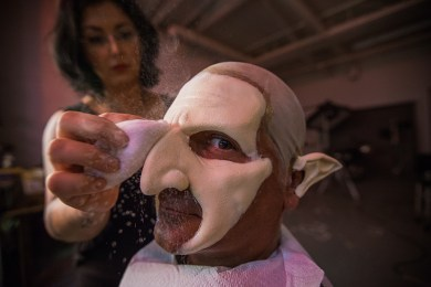 Andrea starts the transformation on ad director Matt Fasang. She applies a bald cap, nose and ear prosthetics and a layer of clay.
