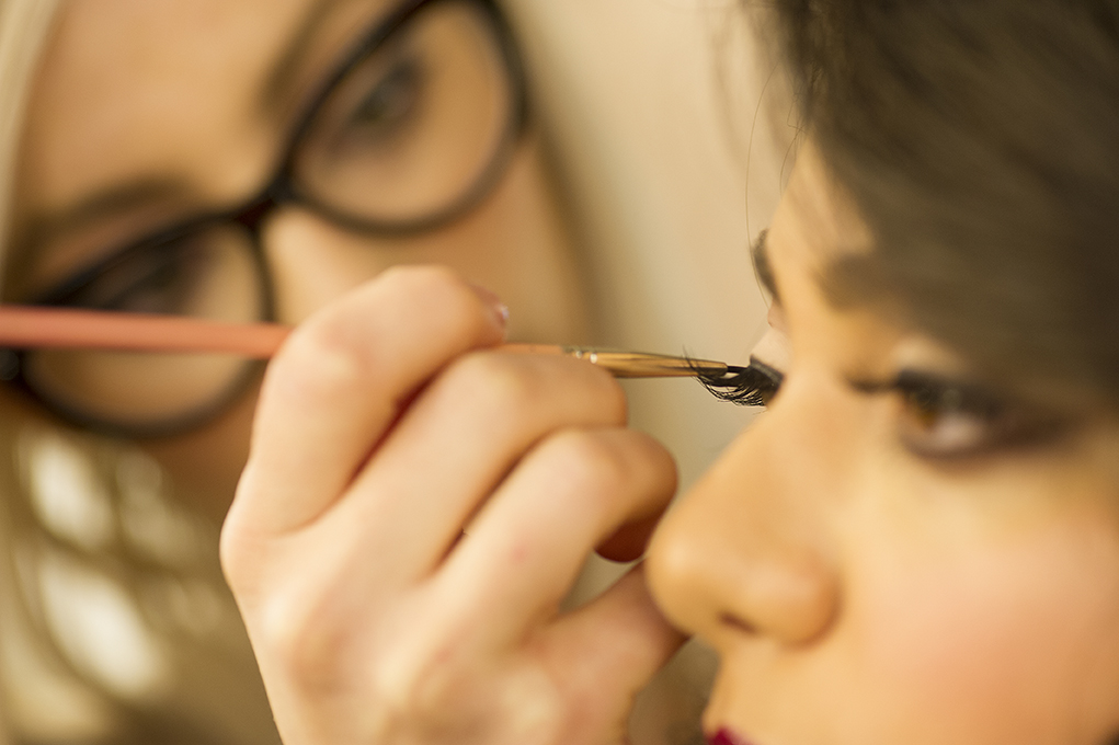 Jessica applies the finishing touches to Crystal's eyes.