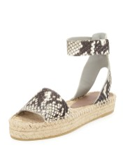 Vince EDIE FLAT-PLATFORM ESPADRILLE ($275) in Black/White, at Neiman Marcus, Somerset Collection, Troy (248-643-3300; neimanmarcus.com).