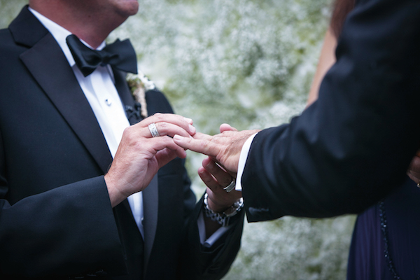 The men exchanged diamond pave rings designed by Steven Tapper.