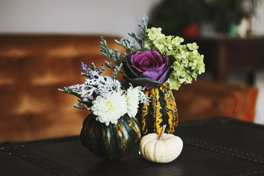DIY GOURD VASES: Caitlin and Manda, bloggers at TheMerrythought.com, cut the tops off a pair of gourds (longer-lasting than pumpkins), scooped out the insides — then filled them with water, pretty flowers and purple cabbage.