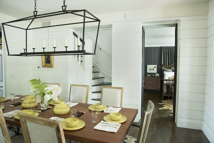 Remodeled dining room with partial view of master bedroom and steps to second floor.