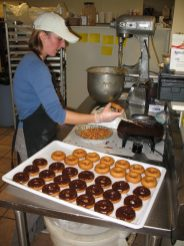 Frosting Donuts at Robinette's Apple Haus in Grand Rapids.