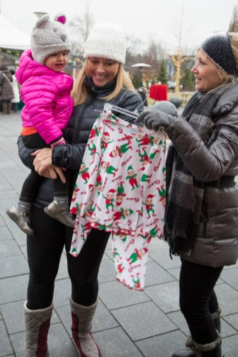 Meghan and Shannon Isola, 1, of Royal Oak and Valerie Schanes of West Bloomfield.