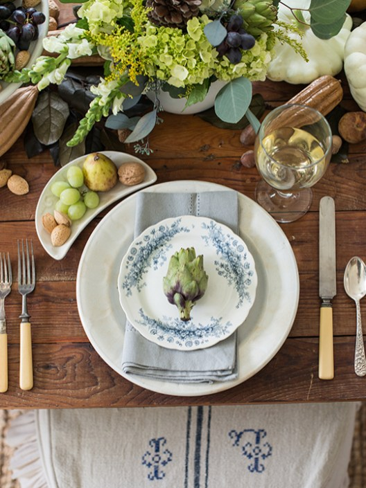 Designer, author, president of Pennsylvania-based Mustard Seed Interiors and blogger (missmustardseed.com) Marian Parsons has styled photo shoots for Country Living, HGTV.com and more. Here, there's no simpler place setting than a sculptural, textural and COLORFUL ARTICHOKE resting on each guest's plate.