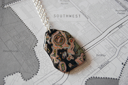 A completed graffiti pendant.