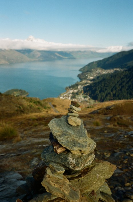 Stones stacked on Queenstown Hill above the lake