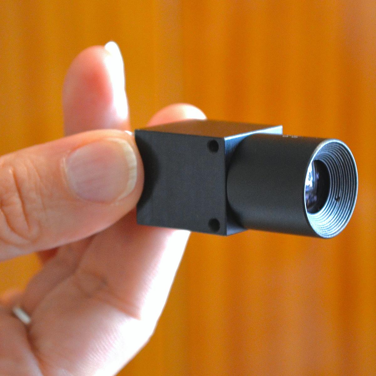WVS-55 miniature welding camera in hand w. background