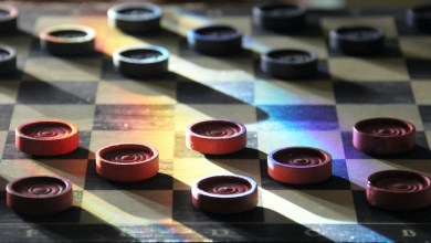 A checkerboard with all pieces in their starting positions.