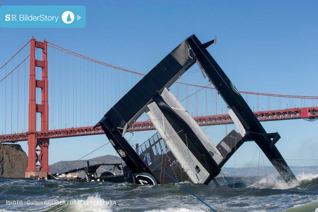 """USA 17″ in Nöten vor der Golden Gate Bridge. © Guilain Grenier / Oracle Team USA"