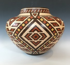 """12"""" diameter by 9"""" high. Made with Maple, Wenge, Bloodwood and Yellowheart. There are over 10,000 pieces that make up this vase. This vase was donated to CHUM for a fundraiser."""