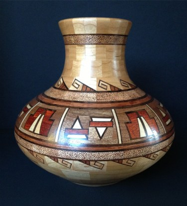 """Burnt Cherry - 7""""; tall by 7.5""""; diameter. Cherry, Sapele, Bubinga, Maple, Wenge and Bloodwood. With this piece I added a little pyrographic detail."""
