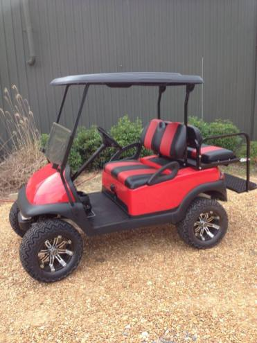 Custom Fender and two tone seats, red cart