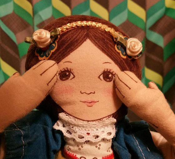 doll, covered ears, hear, sound sensitivity, hearing and seeing, Segullah, Teresa TL Bruce