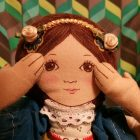 doll, covered ears, hear, sound sensitivity, hearing and seeing, Segullah, Teresa TL Bruce