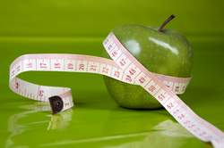 measuring a green apple