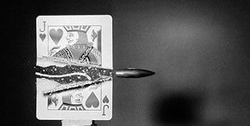 bullet going through playing card