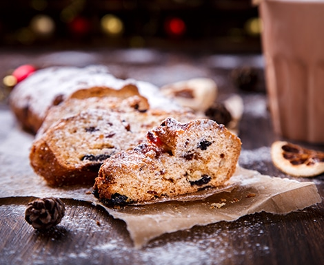 Christmas or New Year pastries Holidays Concept Dresdnen Stollen is a Traditional German Cake Gift Fruit Cake for the Holiday European festive dessert Tradition of Decoration Background
