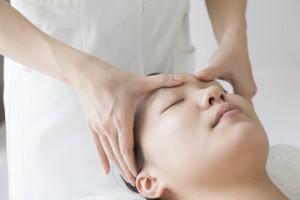 Women undergoing massage of face